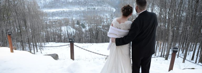 Stroudsmoor Country Inn - Stroudsburg - Wedding Resort - Married Couple Atop A Snowcovered Mountain