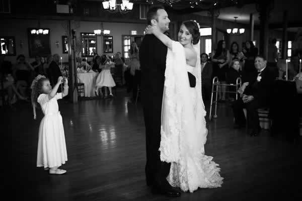 Stroudsmoor Country Inn - Stroudsburg - Poconos - Real Weddings - Flower Girl Capturing Photo Of Bride And Groom
