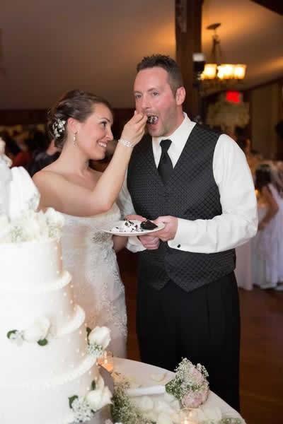 Stroudsmoor Country Inn - Stroudsburg - Poconos - Real Weddings - Bride Feeding Cake To Groom