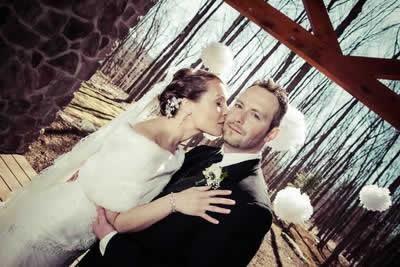 Stroudsmoor Country Inn - Stroudsburg - Poconos - Real Weddings - Bride Giving Groom Quick Kiss On Cheek