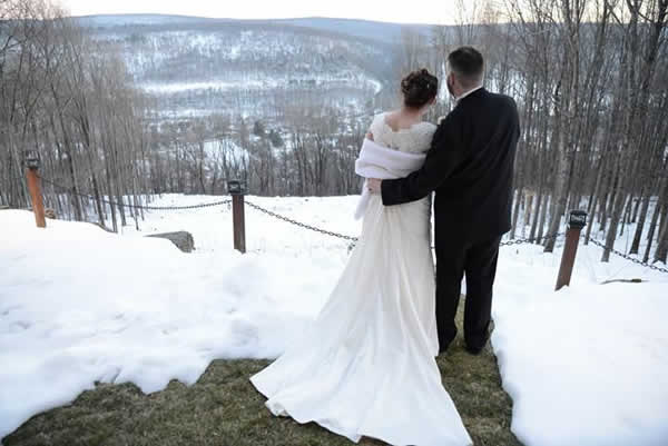 Stroudsmoor Country Inn - Stroudsburg - Poconos - Real Weddings - Bride And Groom Surrounded By Snow Covered Mountains