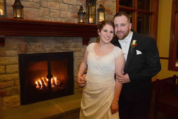 Stroudsmoor Country Inn - Stroudsburg - Poconos - Real Weddings - Bride And Groom Near The Warmth Of The Fireplace