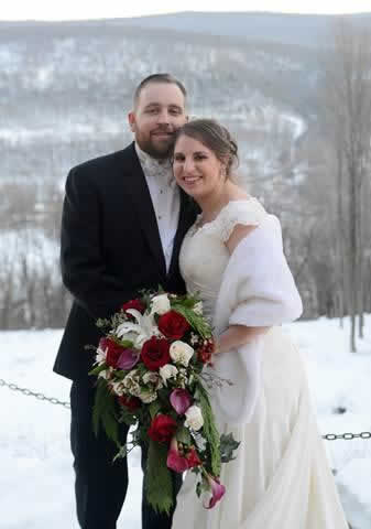 Stroudsmoor Country Inn - Stroudsburg - Poconos - Real Weddings - Bride And Groom Backed By Snow Covered Mountains
