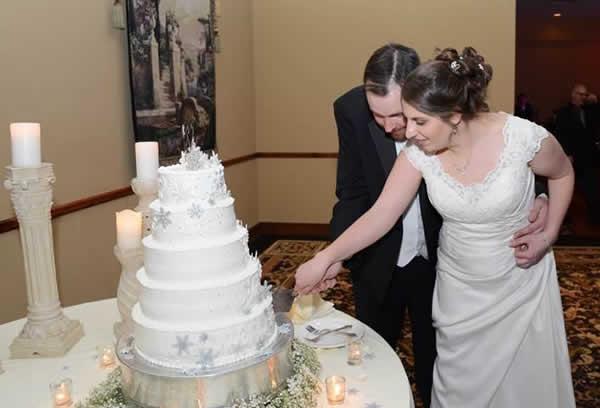 Stroudsmoor Country Inn - Stroudsburg - Poconos - Real Weddings - Bride And Groom Cutting Cake