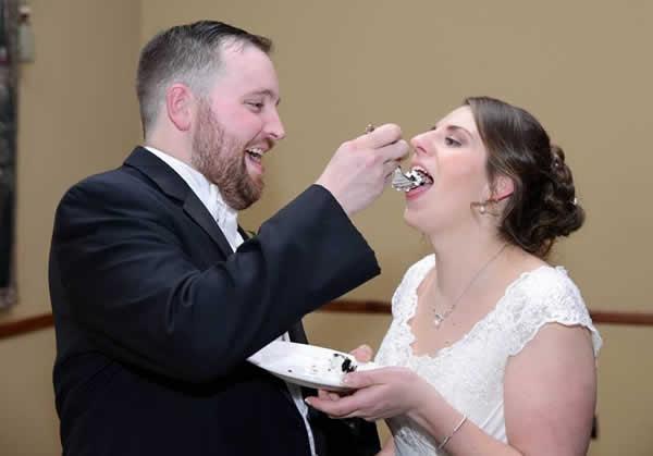 Stroudsmoor Country Inn - Stroudsburg - Poconos - Real Weddings - Groom Feeding Bride Cake