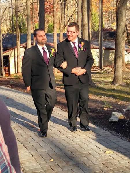 Stroudsmoor Country Inn - Stroudsburg - Poconos - Real Weddings - Happy Couple Walking Arm In Arm