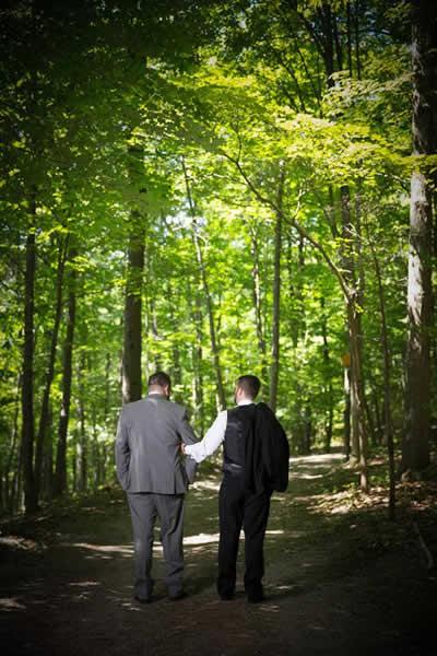 Stroudsmoor Country Inn - Stroudsburg - Poconos - Real Weddings - Happy Couple Stroll Outside