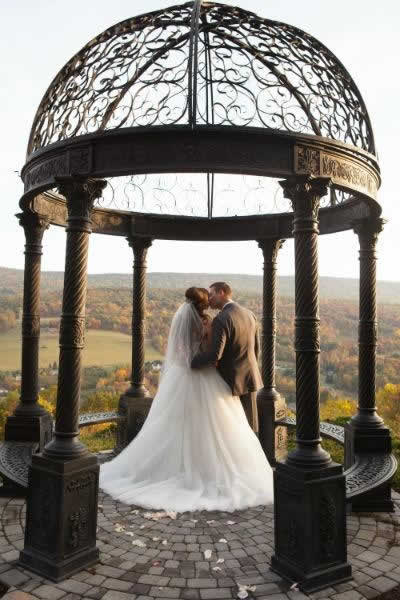 Stroudsmoor Country Inn - Stroudsburg - Poconos - Real Weddings - Newlyweds Kiss In The Gazebo