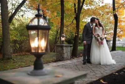 Stroudsmoor Country Inn - Stroudsburg - Poconos - Real Weddings - Romantic Kiss For The Newlyweds Outside
