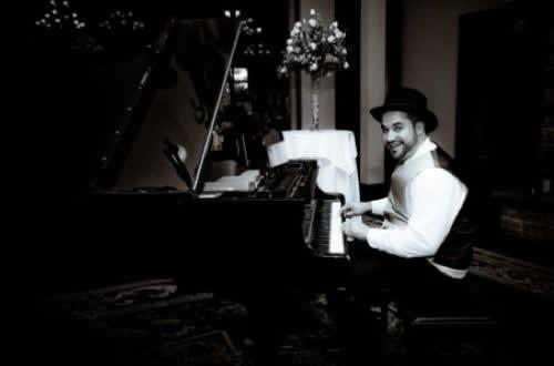 Stroudsmoor Country Inn - Stroudsburg - Poconos - Real Weddings - Groom Playing Piano