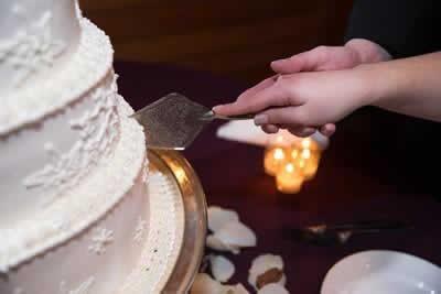 Stroudsmoor Country Inn - Stroudsburg - Poconos - Real Weddings - Bride And Groom Cutting Into The Cake