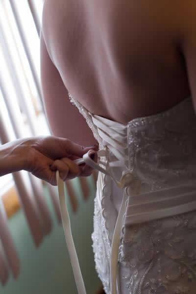 Stroudsmoor Country Inn - Stroudsburg - Poconos - Real Weddings - Bride Getting Dress Laced Up