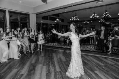 Stroudsmoor Country Inn - Stroudsburg - Poconos - Real Weddings - Bride Looking On After Throwing Bouquet