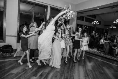 Stroudsmoor Country Inn - Stroudsburg - Poconos - Real Weddings - Guests Trying To Catch Wedding Bouquet