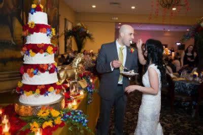 Stroudsmoor Country Inn - Stroudsburg - Poconos - Real Weddings - Bride And Groom Feeding Each Other Wedding Cake