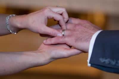 Stroudsmoor Country Inn - Stroudsburg - Poconos - Real Weddings - Bride Putting Ring On Grooms Finger
