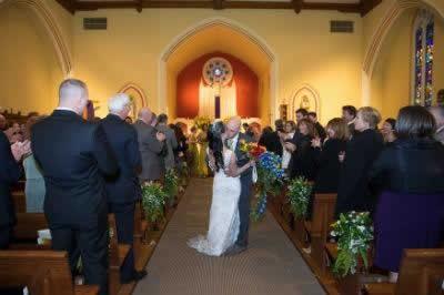 Stroudsmoor Country Inn - Stroudsburg - Poconos - Real Weddings - Newlywed Kissing In Chapel