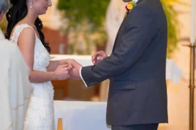 Stroudsmoor Country Inn - Stroudsburg - Poconos - Real Weddings - Groom Putting Ring On Brides Finger