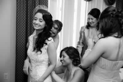 Stroudsmoor Country Inn - Stroudsburg - Poconos - Real Weddings - Bridesmaids Helping Bride With Dress