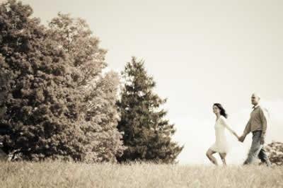 Stroudsmoor Country Inn - Stroudsburg - Poconos - Real Weddings - Newlyweds Walking Out Near Evergreens