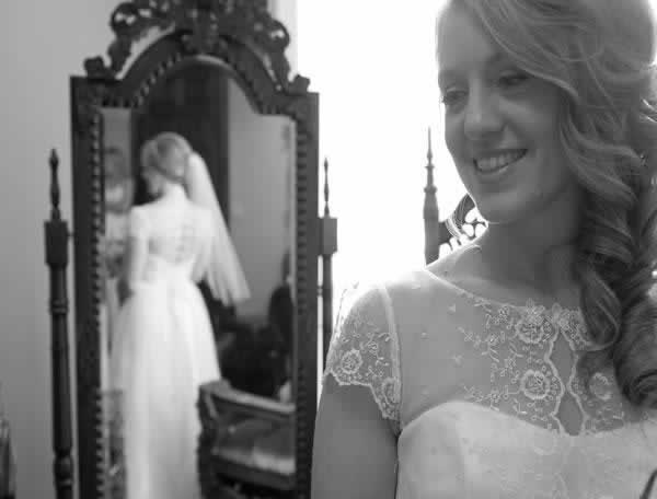 Stroudsmoor Country Inn - Stroudsburg - Poconos - Real Weddings - Bride Gazing At Reflection In Mirror