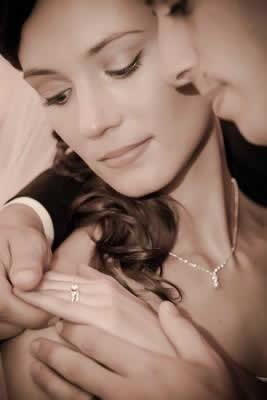 Stroudsmoor Country Inn - Stroudsburg - Poconos - Real Weddings - Bride And Groom Gazing At Brides Wedding Ring