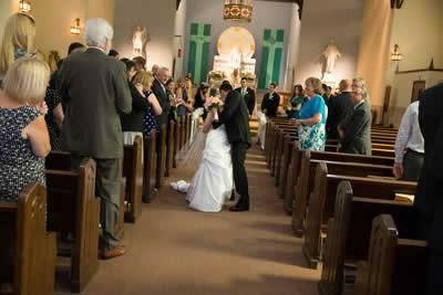 Stroudsmoor Country Inn - Stroudsburg - Poconos - Real Weddings - Bride And Groom Kissing In Chapel