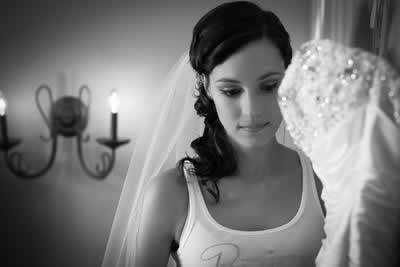 Stroudsmoor Country Inn - Stroudsburg - Poconos - Real Weddings - Bride Posing With Wedding Dress