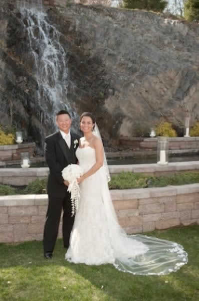Stroudsmoor Country Inn - Stroudsburg - Poconos - Real Weddings - Couple Outside Near Garden With Waterfalls
