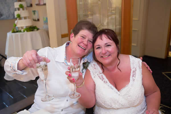 Stroudsmoor Country Inn - Stroudsburg - Poconos - Real Weddings - Happy Couple Toasting