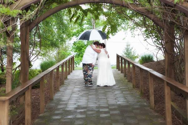 Stroudsmoor Country Inn - Stroudsburg - Poconos - Real Weddings - Happy Married Couple Under Outdoor Trellis