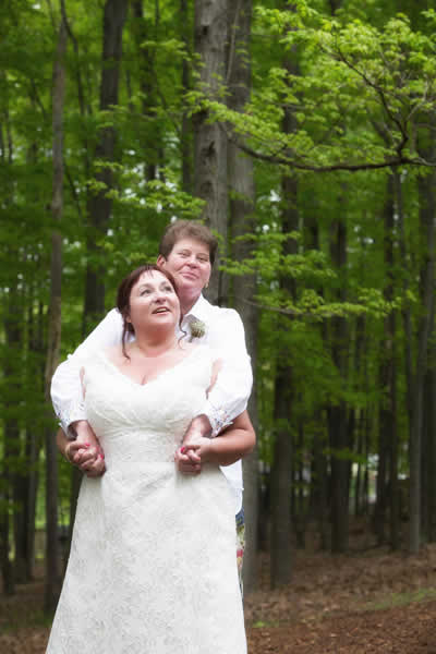 Stroudsmoor Country Inn - Stroudsburg - Poconos - Real Weddings - Happy Couple Surrounded By The Tall Trees