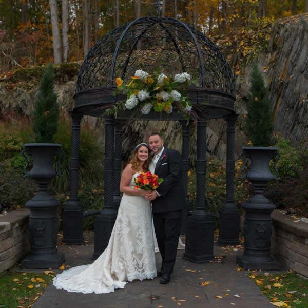 Stroudsmoor Country Inn - Stroudsburg - Poconos - Real Weddings - Bride And Groom Posing Near Outdoor Gazebo