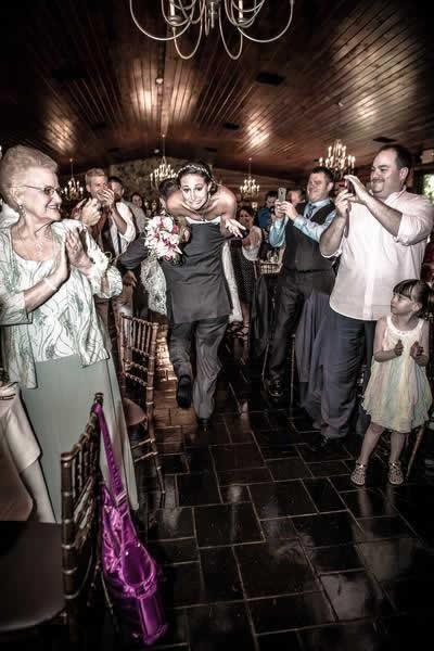 Stroudsmoor Country Inn - Stroudsburg - Poconos - Real Weddings - Groom Carrying Bride Over His Shoulders