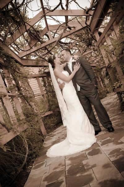 Stroudsmoor Country Inn - Stroudsburg - Poconos - Real Weddings - Bride And Groom Under Trellis