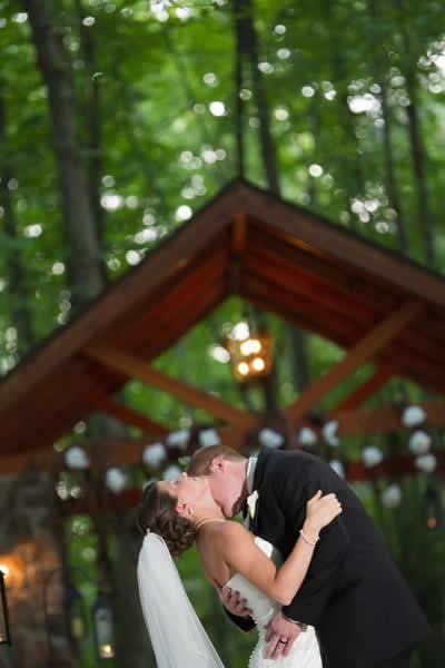 Stroudsmoor Country Inn - Stroudsburg - Poconos - Real Weddings -Bride And Groom Near Outdoor Covered Bridge