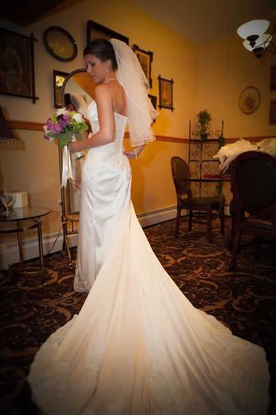 Stroudsmoor Country Inn - Stroudsburg - Poconos - Real Weddings - Bride Posing Near Mirror