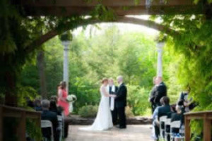 Stroudsmoor Country Inn - Stroudsburg - Poconos - Intimate Wedding - Bride And Groom In Auradell Grotto Joined By Wedding Party