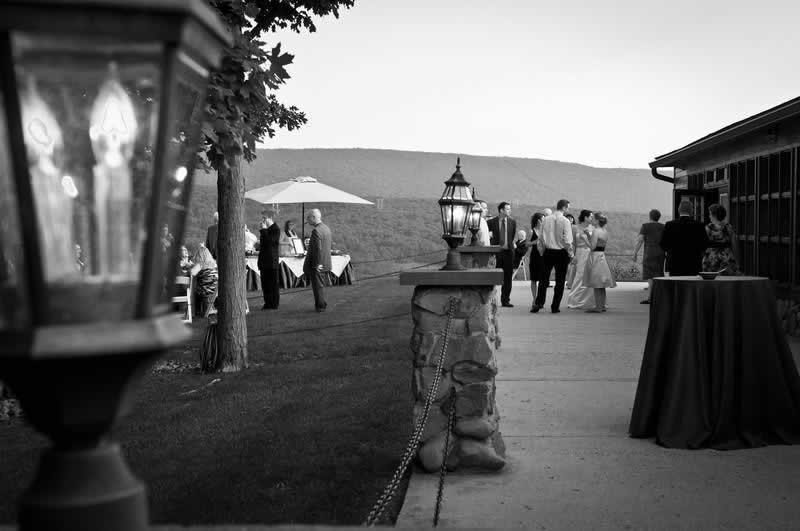 Stroudsmoor Country Inn - Stroudsburg - Poconos - Pocono Mountain Wedding - Wedding Guests Celebrating In Open Air Forum