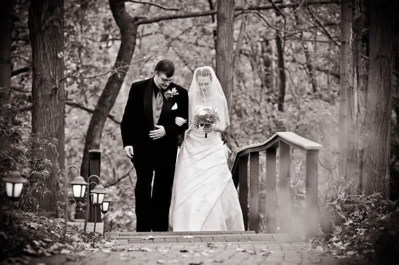 Stroudsmoor Country Inn - Stroudsburg - Poconos - Woodlands Outdoor Wedding - Bride And Groom Exiting On Staircase