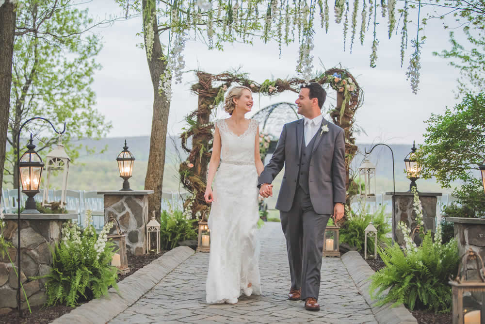 Wedding couple posing, holding hands