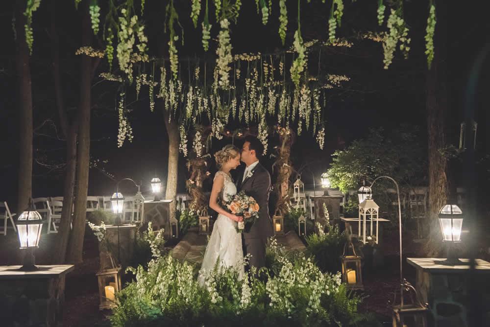 Wedding couple posing, groom kissing bride on forehead