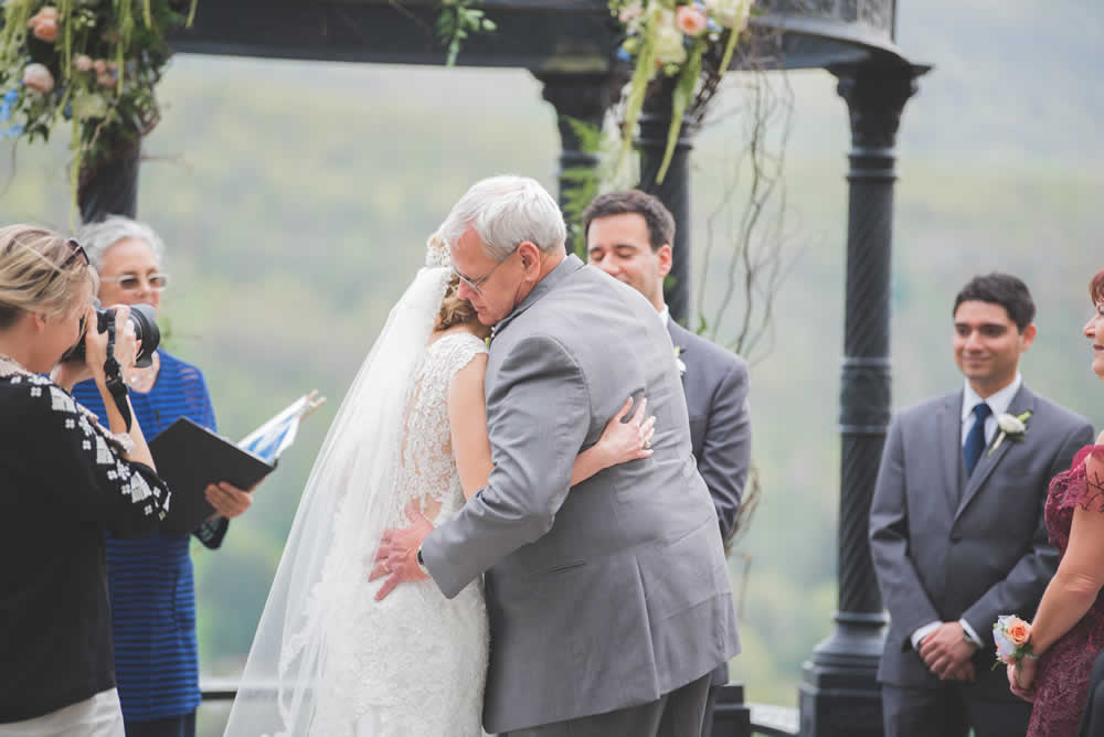 Bride hugging her father at ceremony