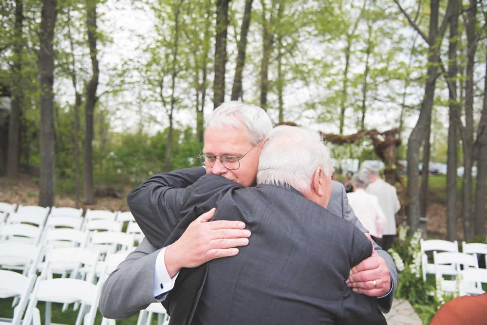 Men hugging during wedding