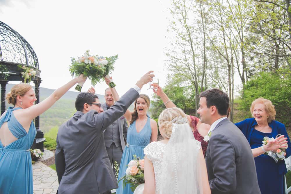 Wedding party toasting couple