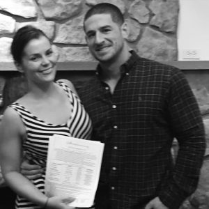 Stroudsmoor Country Inn - Wedding Warrior - Couple after signing wedding contract