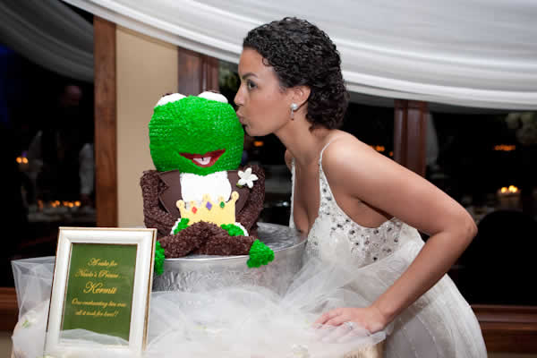 Bride kissing Kermit the Frog cake.