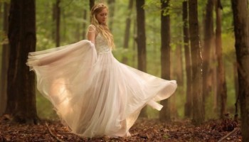 Bride walking through the forest
