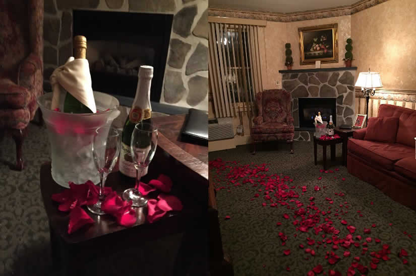 Champagne and rose petals in room