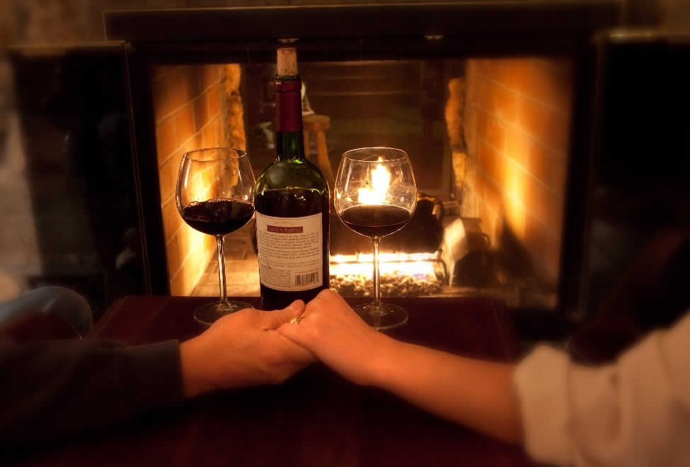 Couple holding hands fireplace